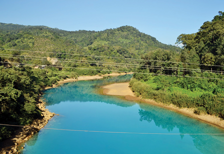 The Lukha River in Jaintia Hills, near the border with Bangladesh, runs Gatorade blue due to sulphate pollution from Meghalaya's coal mines.